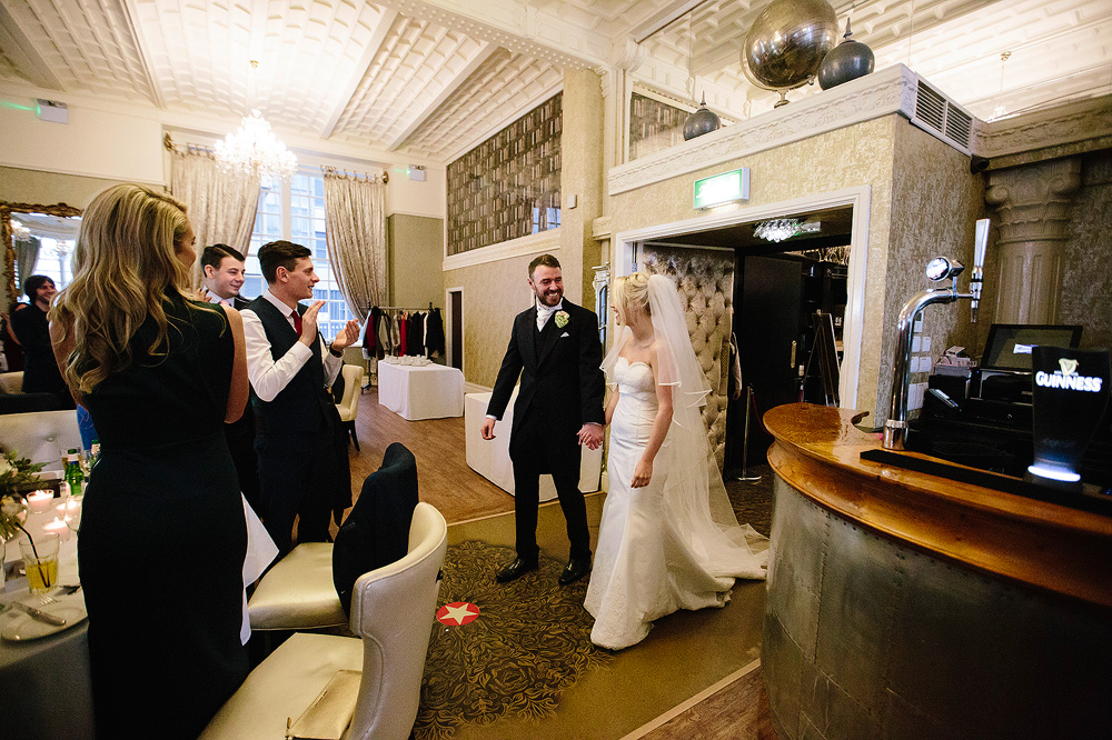 The brdie and groom enter the room.
