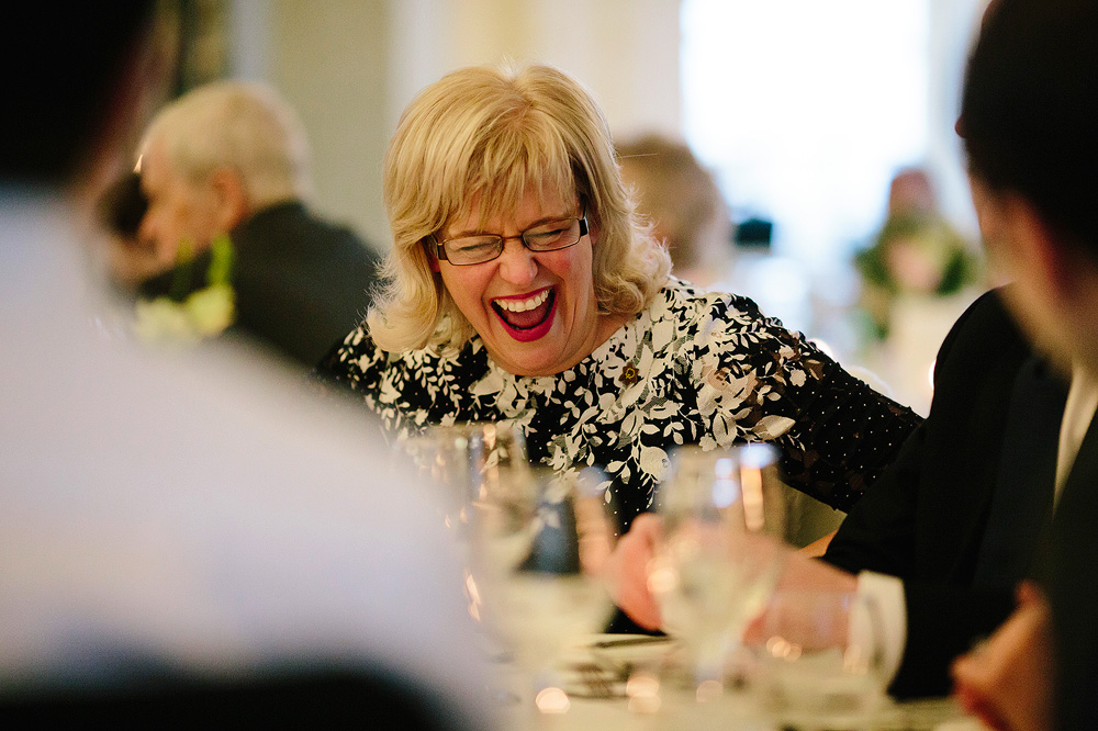 One of the guests laughs heartily.
