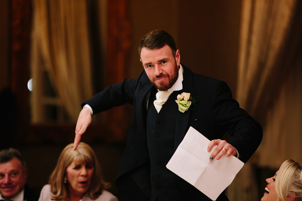 The groom does a funny dance.