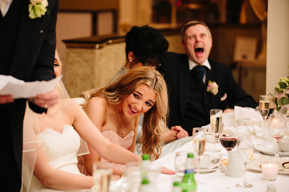 Everyone laughs at the groom's speech.