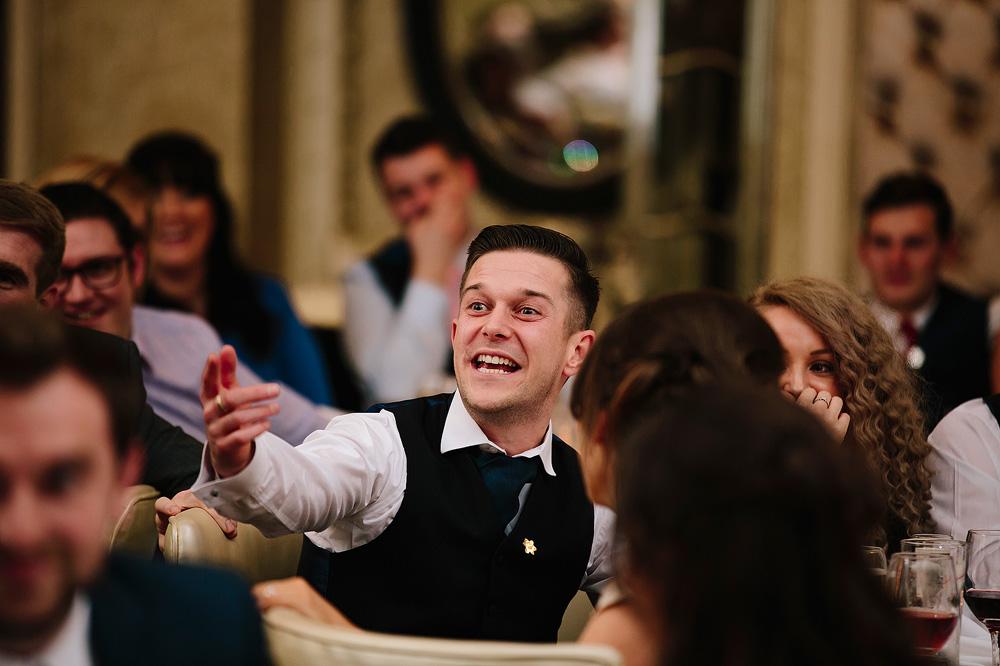 A groomsman heckles the speaker.
