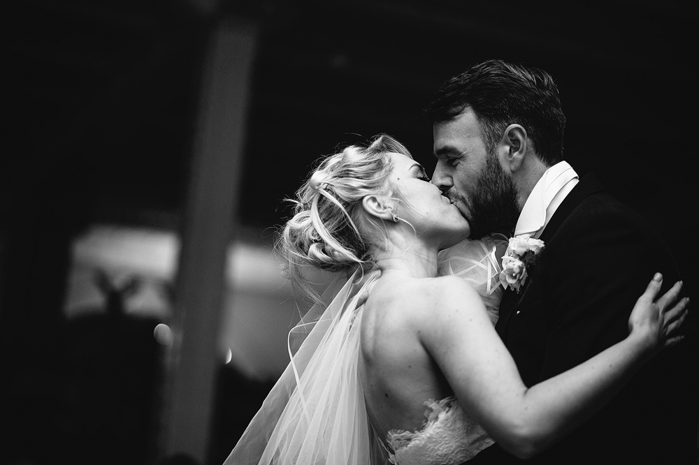 The couple share a kiss and dance together.