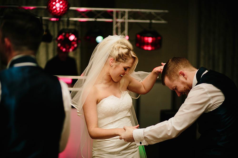 The bride dances with a guest.