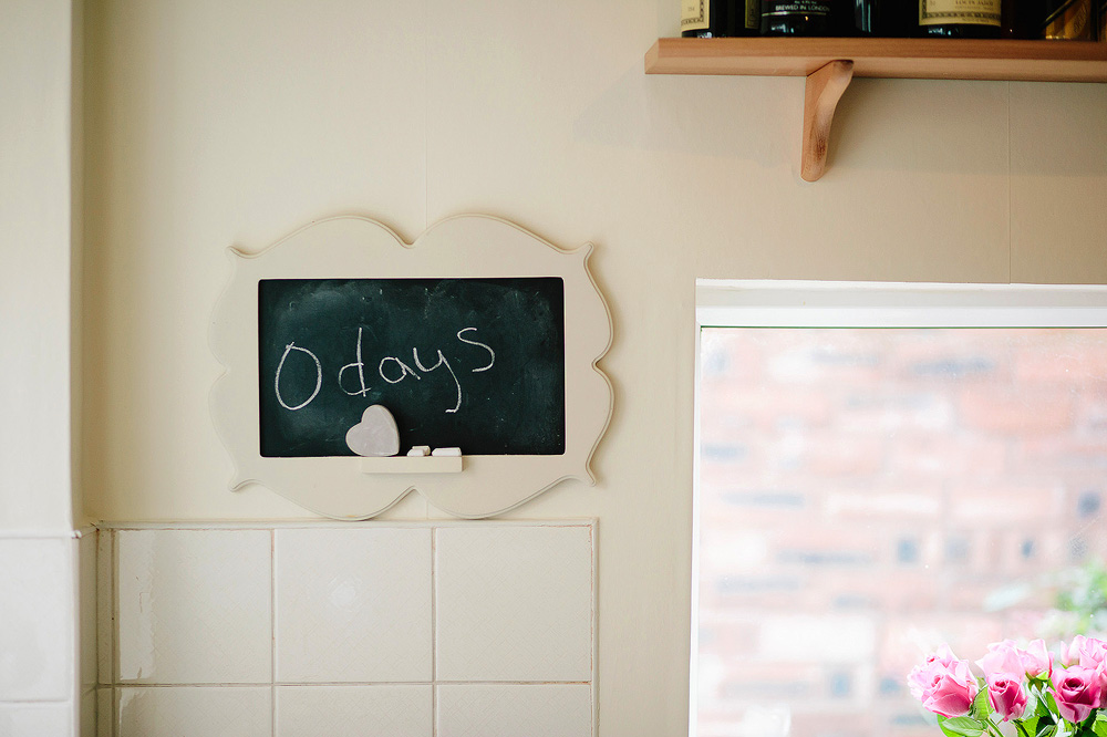 A blackboard shows a countdown to the wedding day.
