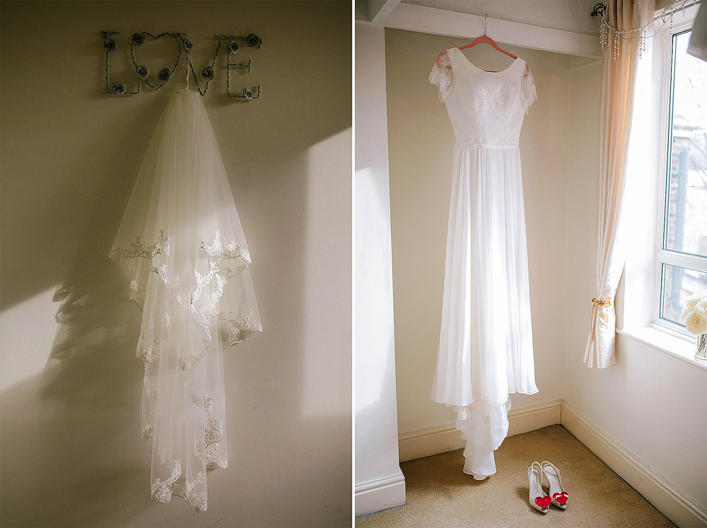 The wedding dress and veil hanging up.