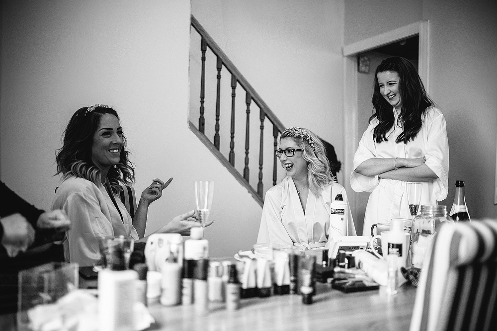 The girls share a joke and chat for a while.