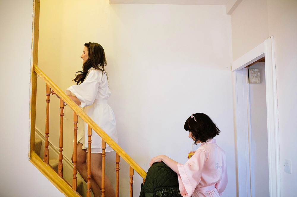 The bride goes upstairs to try on her dress.
