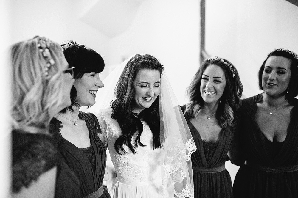 The girls laugh together as they are ready to go.