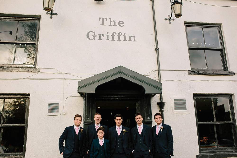 The groomsmen are ready outside the local pub.