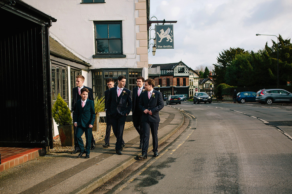 The lads walk to the bowdon rooms for the wedding.