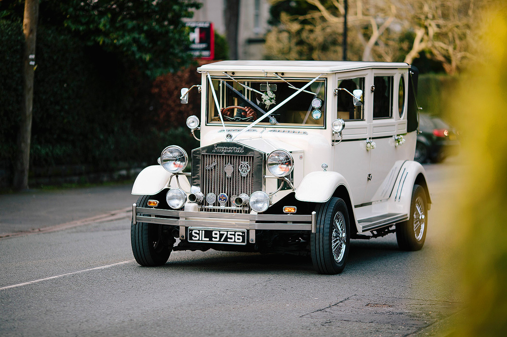 The vintage wedding car.