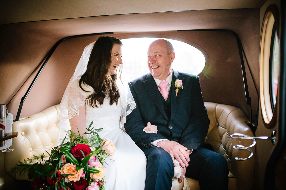 The bride and her dad in the car.