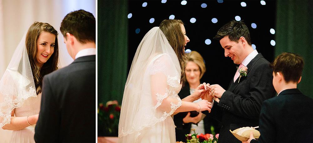 Tom puts the ring on Charlotte's finger.