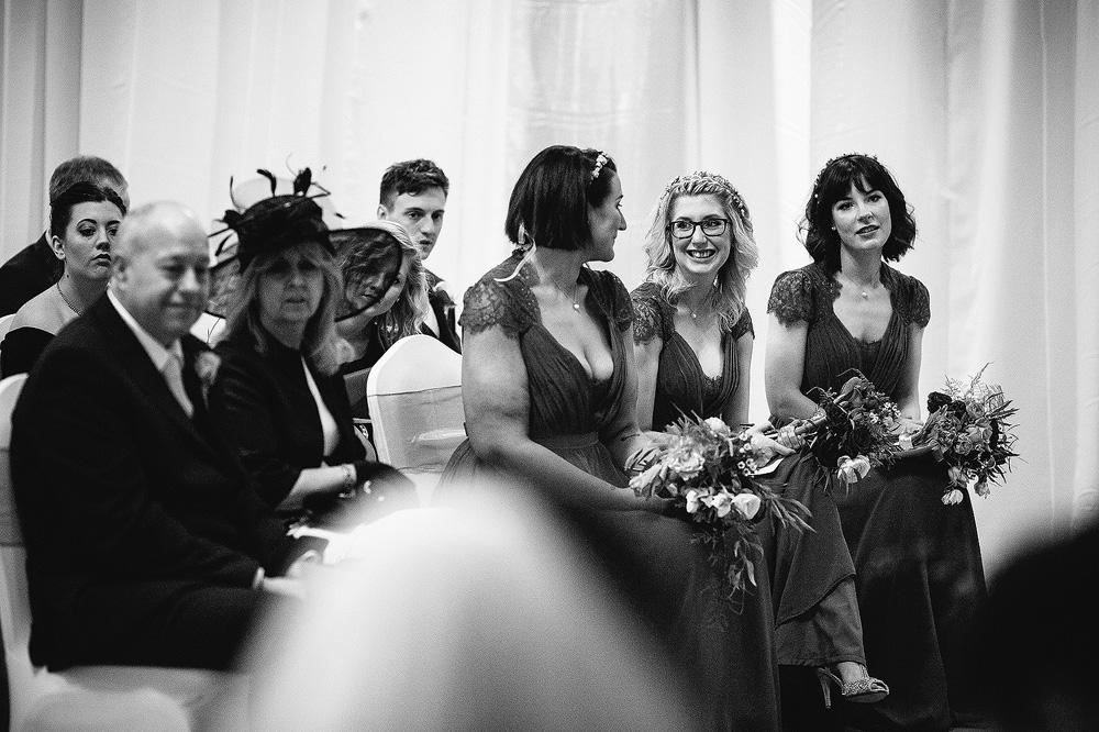 The bridesmaids enjoy the ceremony.