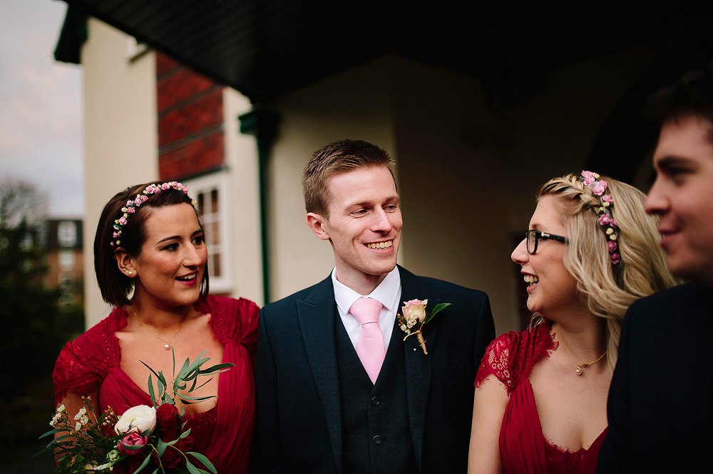 A smiling groomsman.