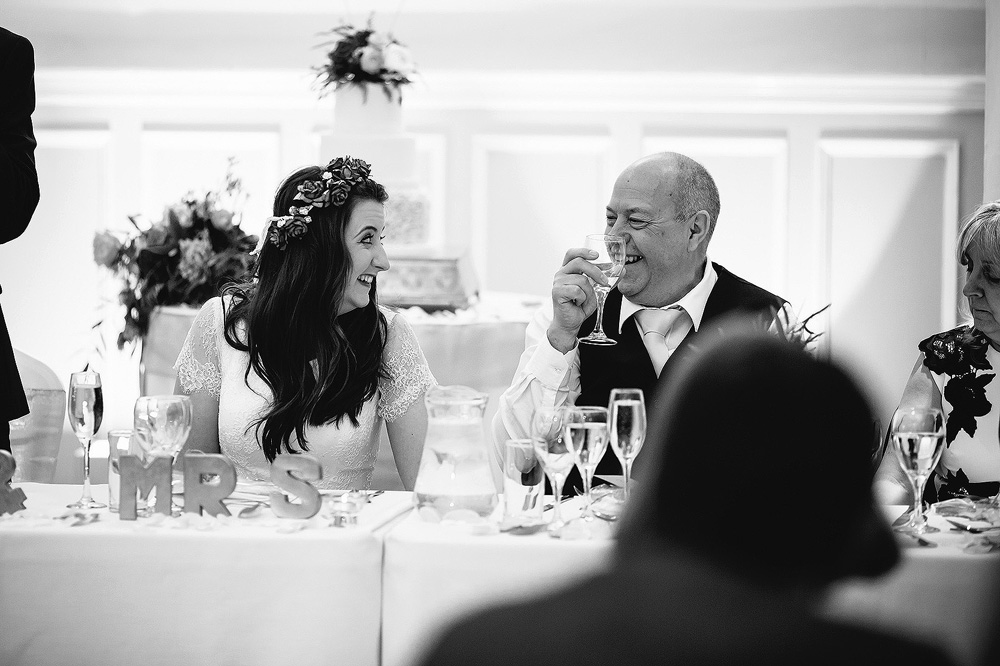 Charlotte and her dad look at each other.
