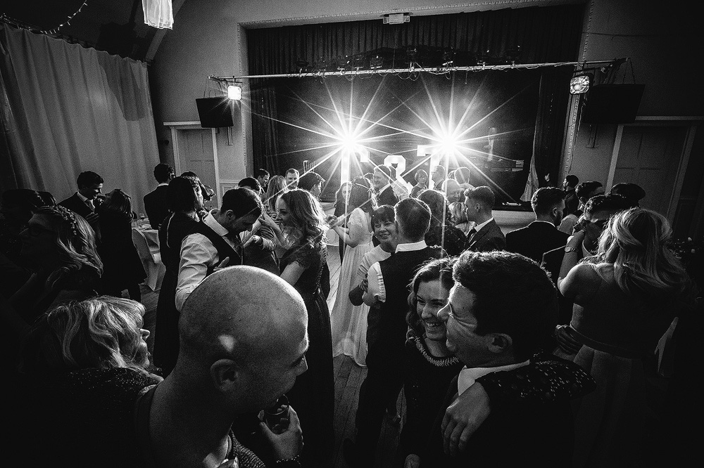 The dance floor is filled with people enjoying the wedding at the bowdon rooms.