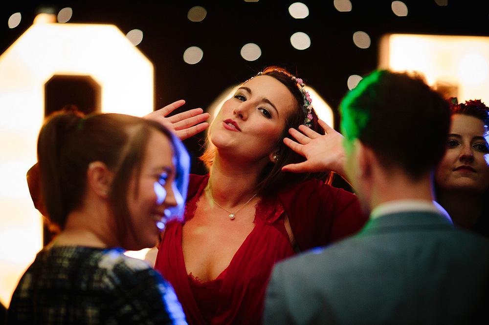 A bridesmaid strikes a pose on the dance floor.