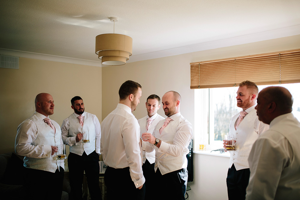 thegroomsmen help the groom to get ready for the wedding
