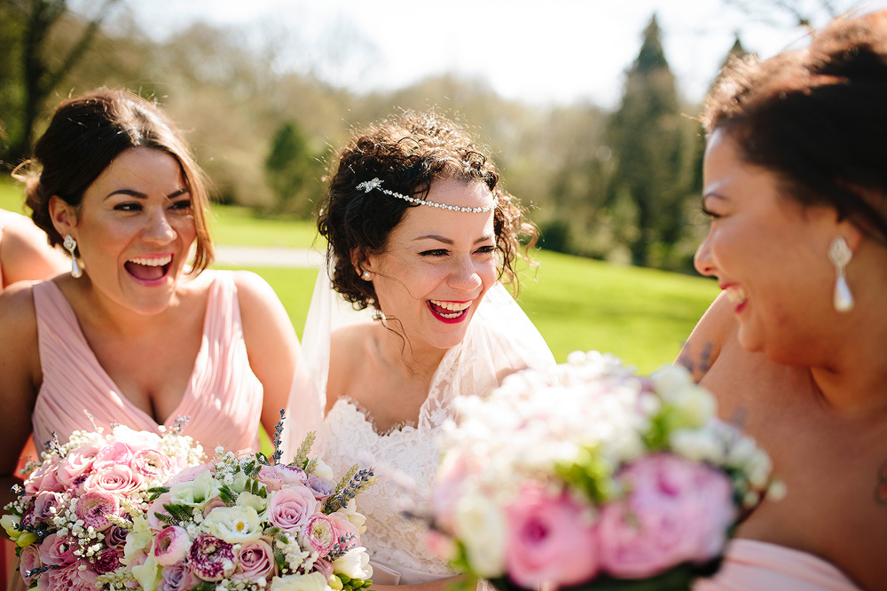 The bride laughs with her friends.
