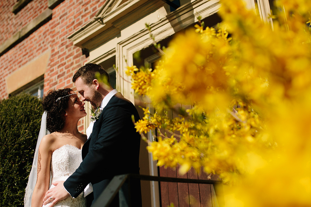 Yellow flowers look amazing next to the bride and groom.