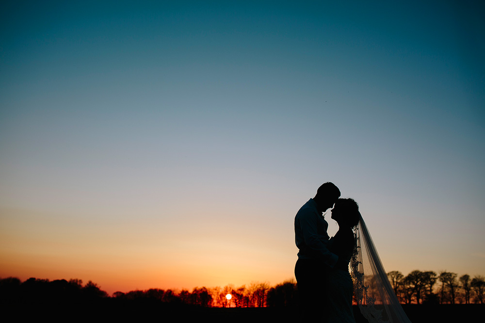 The sunset shot of the bride and groom.