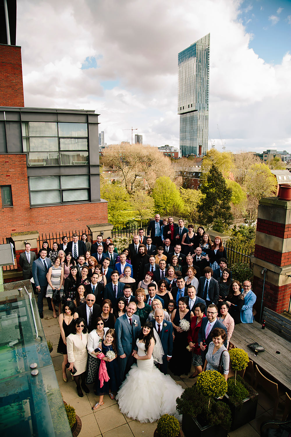 everybody together on the roof terrace overlooking beetham tower
