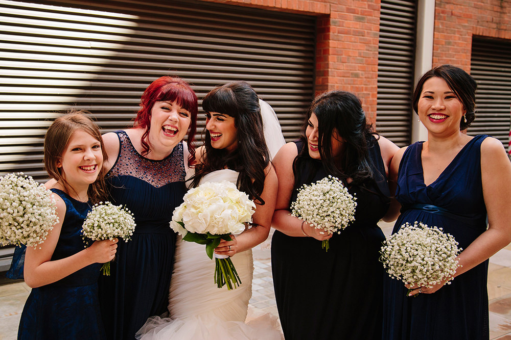 the bridal party laugh together