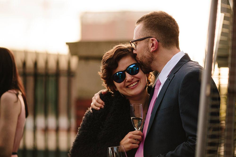 a guest hugs and kisses his partner