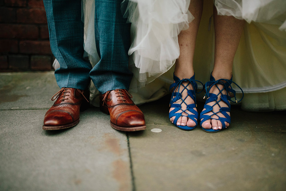the bride and groom's feet