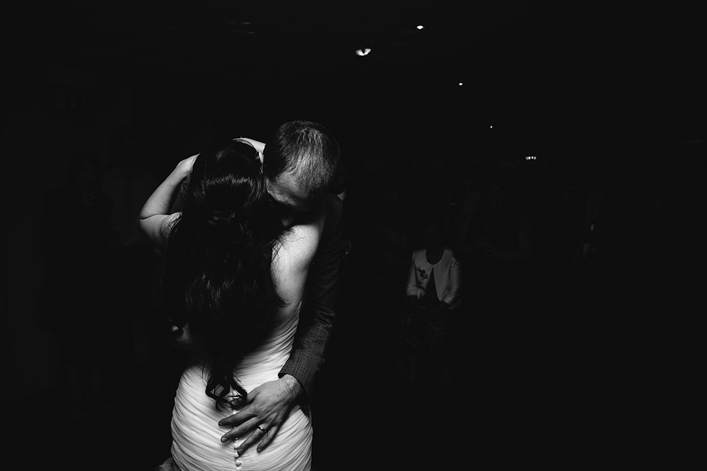 a black and white photo of the couple on the dancefloor