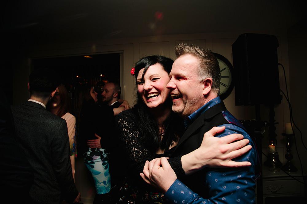 a couple hug and laugh