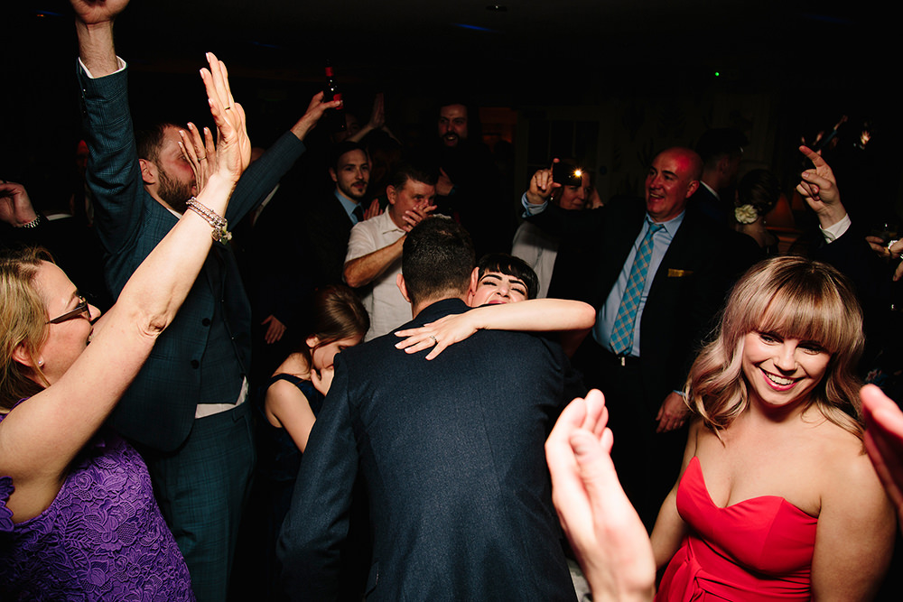 bride having a good time on the dancefloor