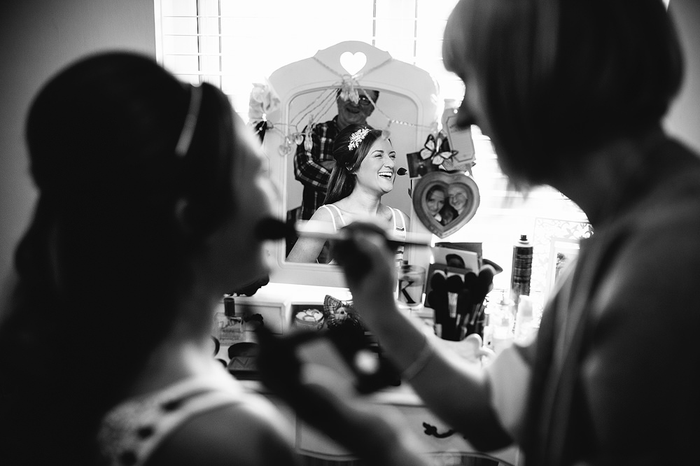 bride having her make up put on