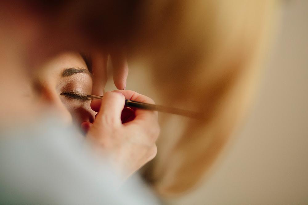 close up of eyelashes having mascara applied