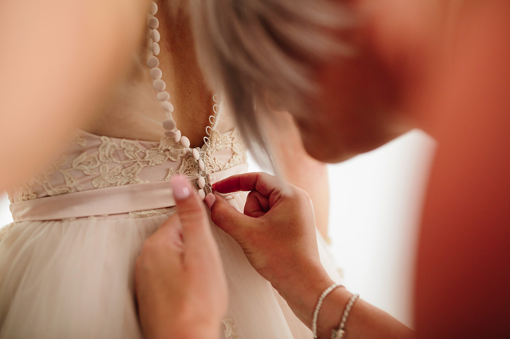 close up of the dress being fastened