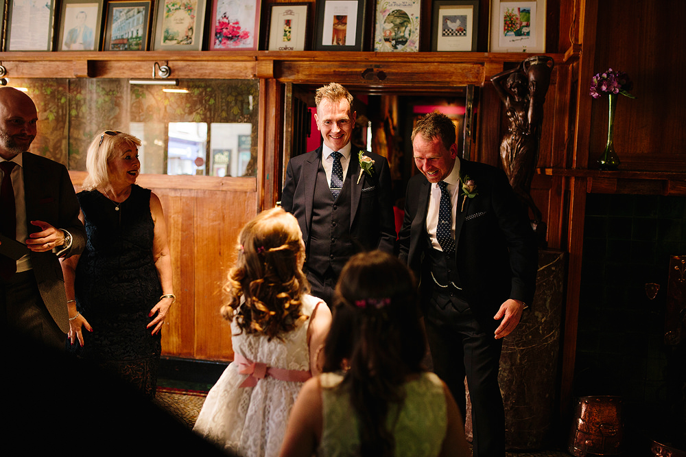 the groom greets the flowergirls