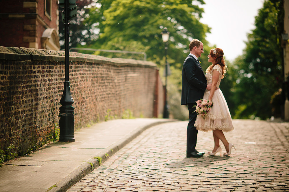 bride and groom on the cobbles
