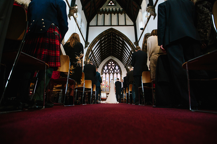 a view from the back of the church as they get married