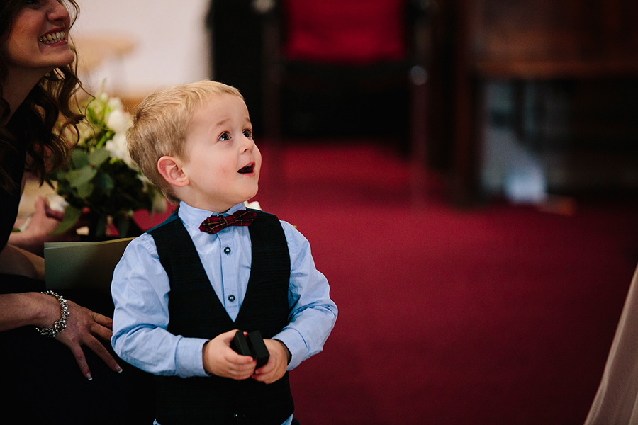 the young boy delivers the wedding rings