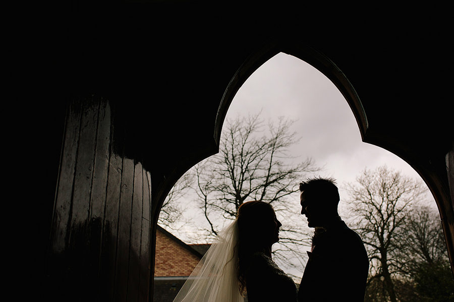 the couple in the doorway of the church