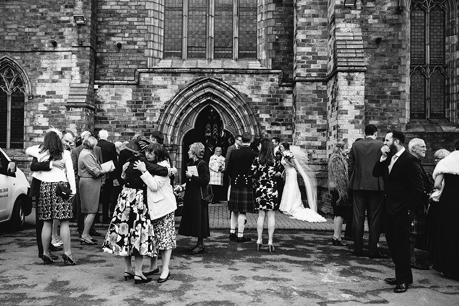 a documentary wedding photography photo outside the church