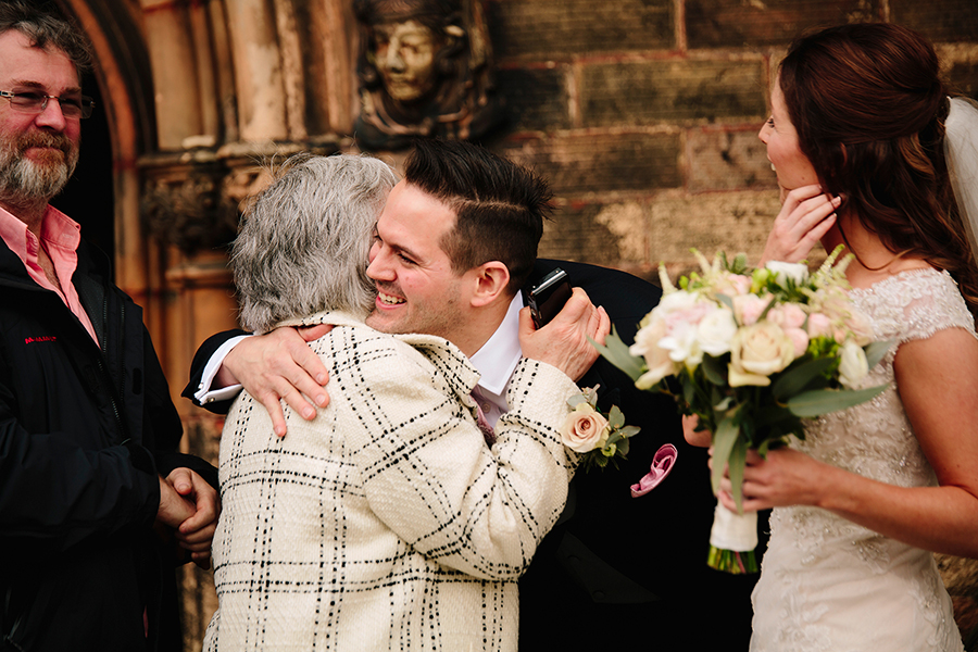 the groom hugs someone