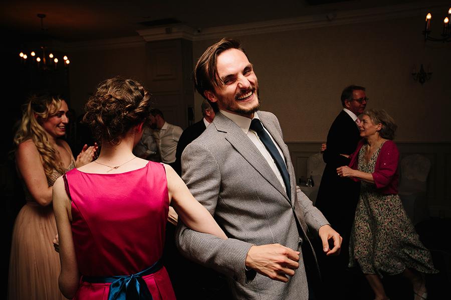 a bloke dances and laughs