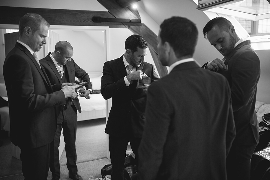 the groom checks his wedding suit at colshaw hall
